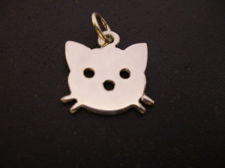 Kitty cat head silhouette pendant sterling silver handmade by saw piercing