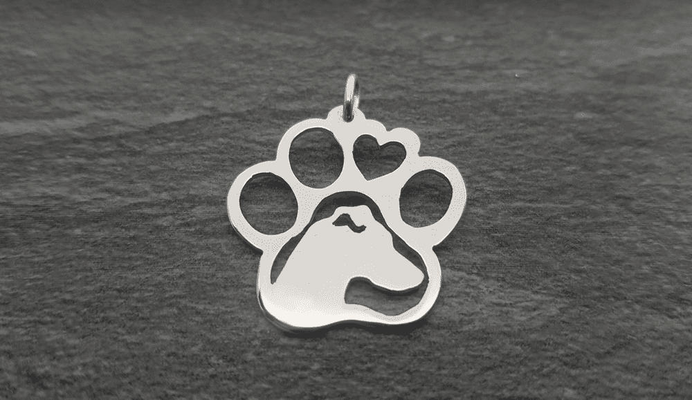 Miniature pinscher Head in a paw  pendant sterling silver handmade by saw piercing