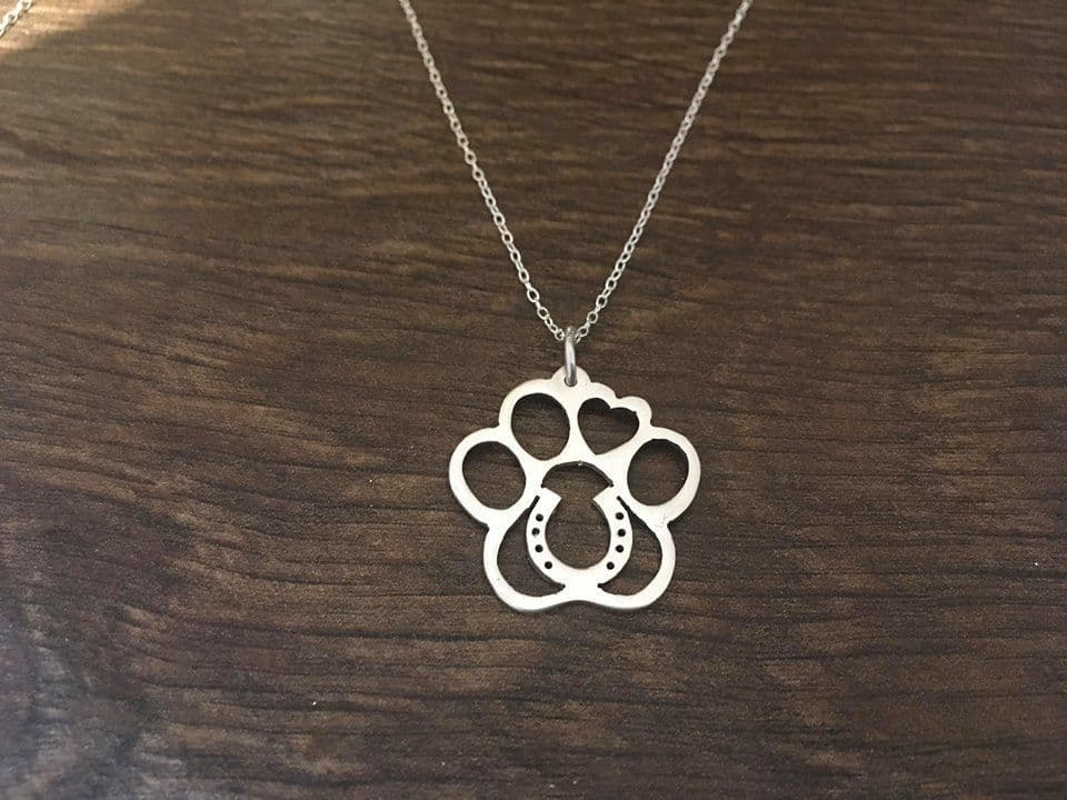 paw with a horse shoe pendant sterling silver handmade by saw piercing