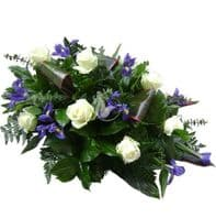 White,blue iris, roses  casket